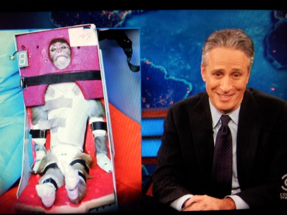 "Iran has successfully launched a live monkey into space. Comedian Jon Stewart described the monkey as ""seen here doing it's best 'Han Solo frozen in Carbonite' impression"". Image: Comedy Central via inothernews."