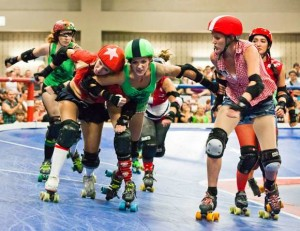 Roller Derby game between the Cherry Bombs (Green) vs Rhinestone Cowgirls (Red) on Aug 27, 2011, in Austin, Texas. Image: Earl McGehee / WikiMedia Commons