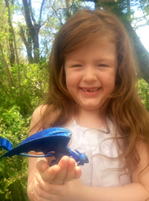 Seven-year-old Sophie holding Toothless, the 3D printed dragon made for her by the CSIRO. Photo: Vanessa Hill, CSIRO.